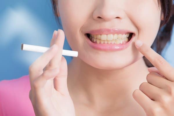 Maintain oral hygiene while smoking